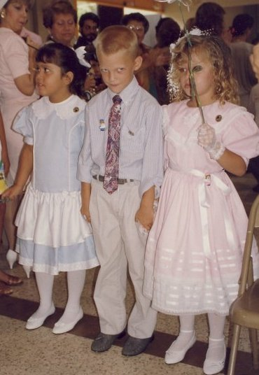 In Puerto Rico, Kindergartners graduate from their class. Here is me on that day in a class that had more girls than boys.